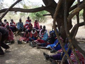 9. HIV workshop at Wosiwosi, women examining a condom
